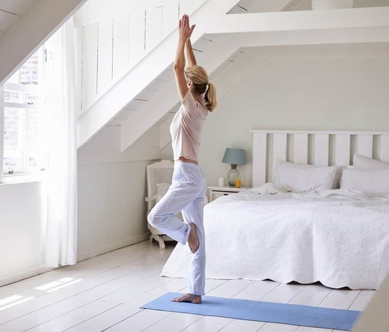 Woman doing practicing yoga - part of the exercise of Miracle Morning