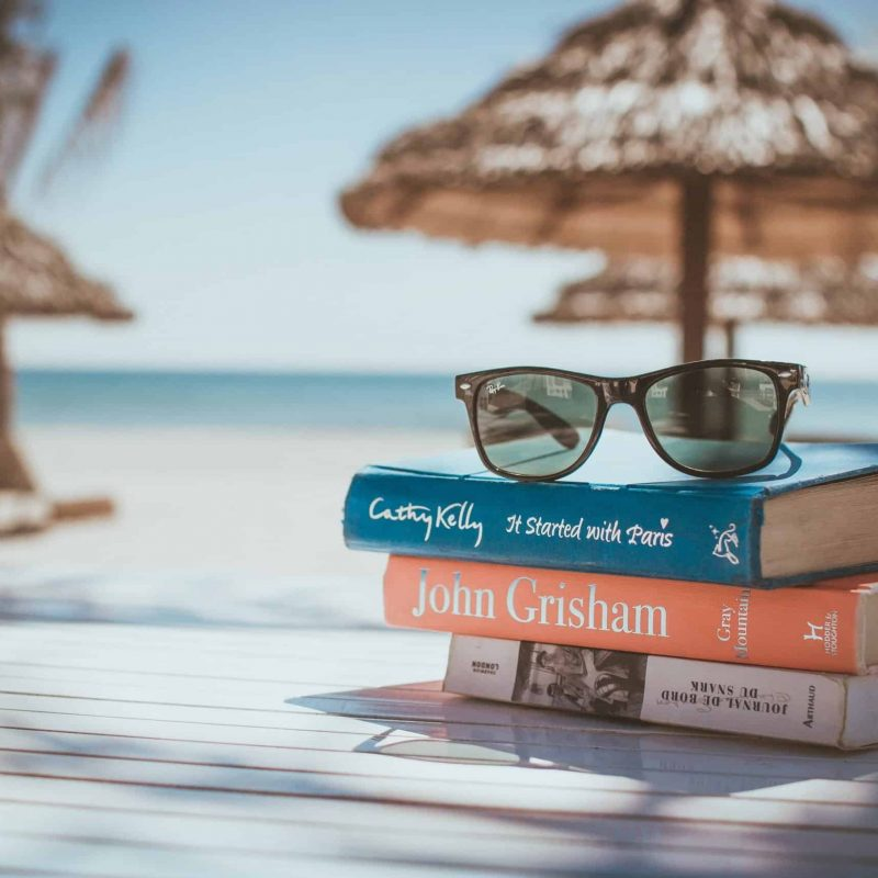 A stack of books at the beach